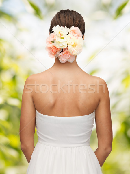 woman with flowers in her head Stock photo © dolgachov