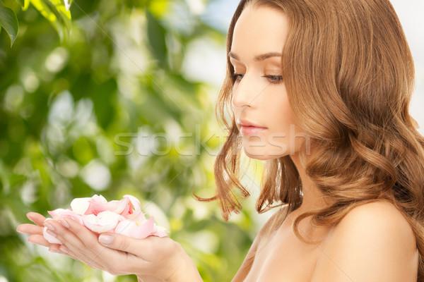 beautiful woman with rose petals Stock photo © dolgachov