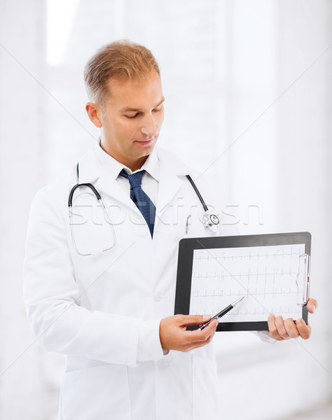 male doctor with stethoscope showing cardiogram Stock photo © dolgachov