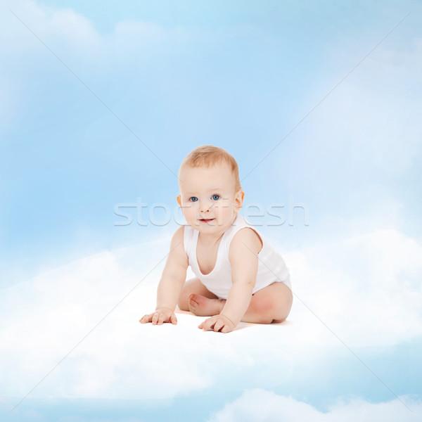 smiling baby sitting on the cloud Stock photo © dolgachov