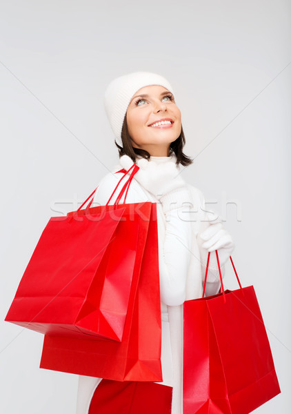 picture of happy woman with shopping bags Stock photo © dolgachov