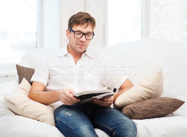 man with magazine at home Stock photo © dolgachov