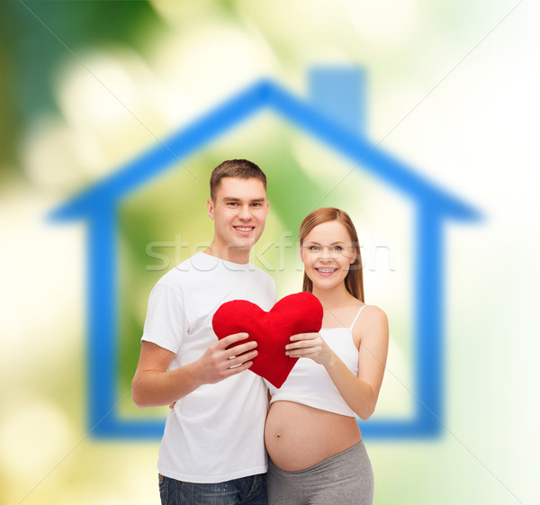 happy young family expecting child with big heart Stock photo © dolgachov