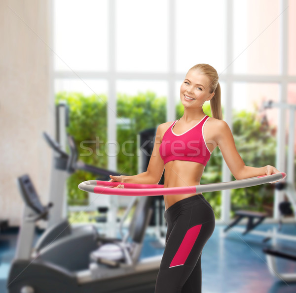 young sporty woman with hula hoop at gym Stock photo © dolgachov