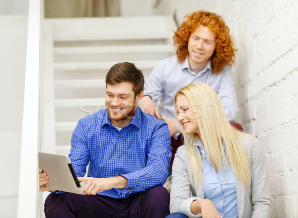 team with tablet pc computer sitting on staircase Stock photo © dolgachov