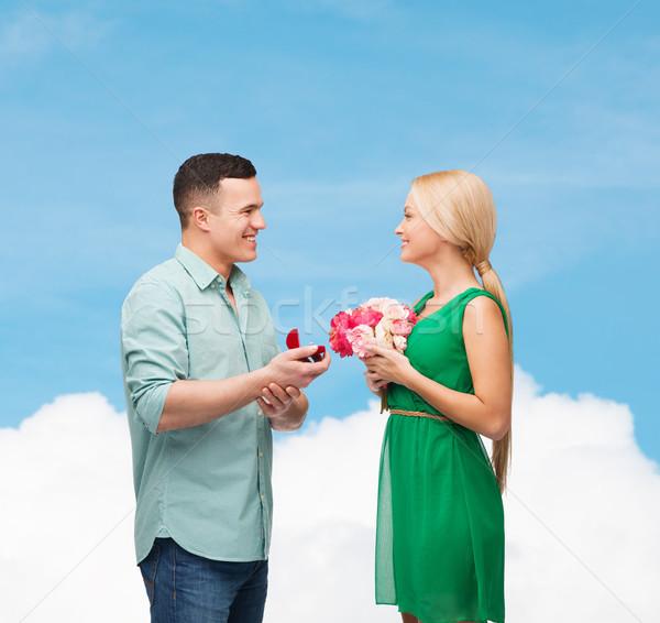 Sorridente casal anel felicidade férias Foto stock © dolgachov