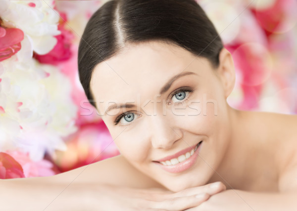 smiling woman in spa lying on the massage desk Stock photo © dolgachov