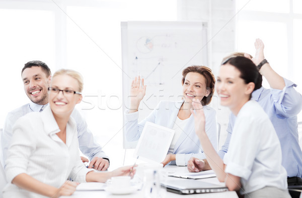 Stock photo: business team having meeting in office