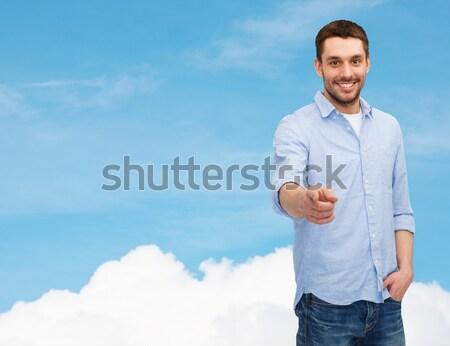 smiling man pointing finger at you Stock photo © dolgachov