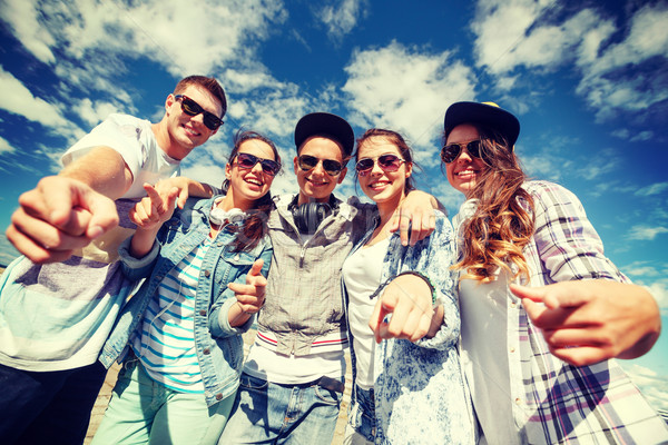 smiling teenagers in sunglasses hanging outside Stock photo © dolgachov