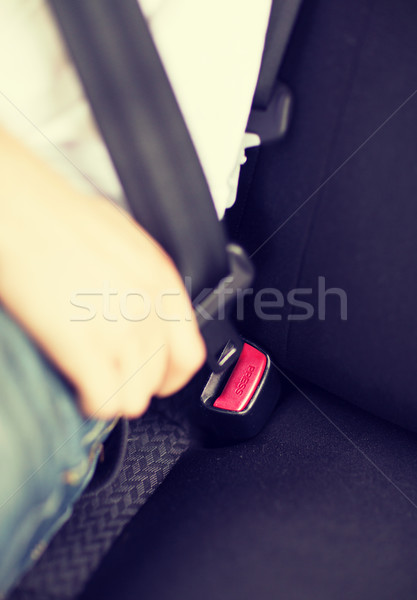 man fastening seat belt in car Stock photo © dolgachov
