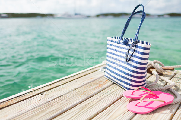 close up of beach accessories on wooden pier Stock photo © dolgachov