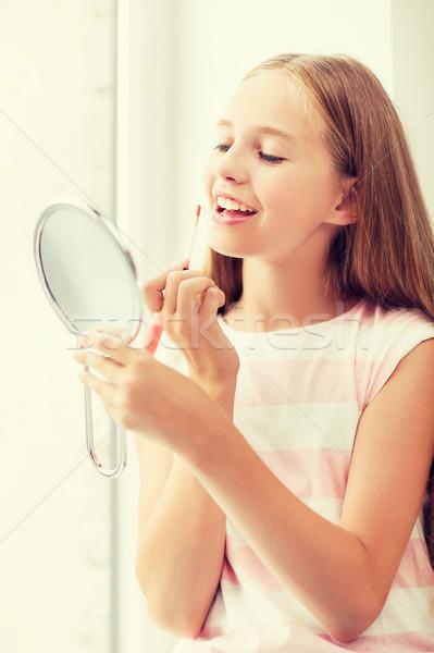 Lip gloss specchio adolescenza bellezza trucco Foto d'archivio © dolgachov