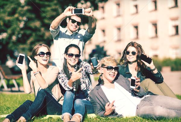 Stock photo: students showing smartphones