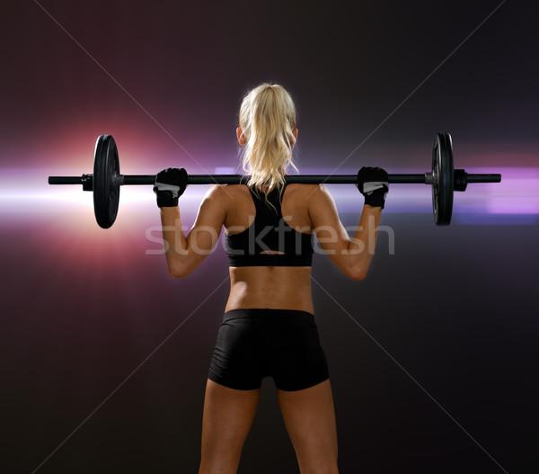 Sportos nő testmozgás súlyzó hát fitnessz Stock fotó © dolgachov