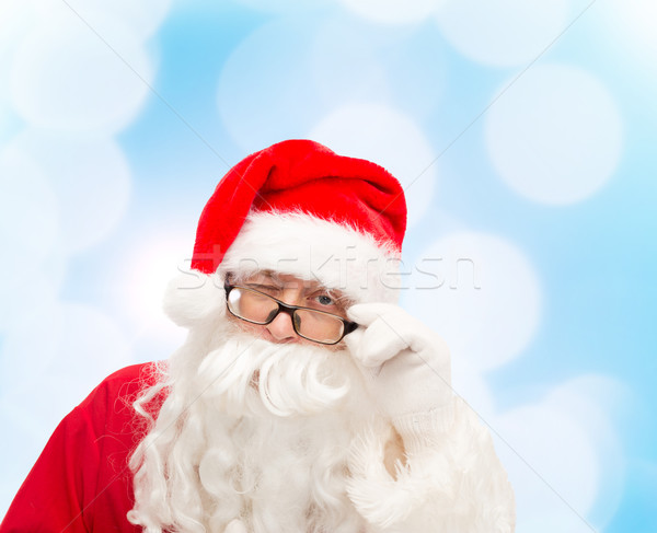 close up of santa claus winking Stock photo © dolgachov
