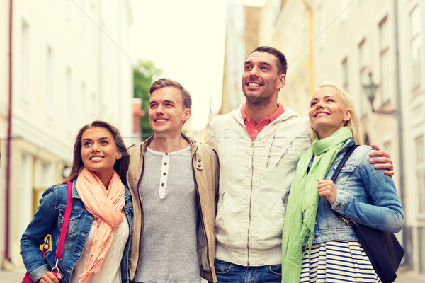 Csoport mosolyog barátok sétál város barátság Stock fotó © dolgachov