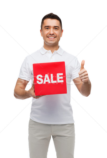 smiling man with red sale sigh showing thumbs up Stock photo © dolgachov