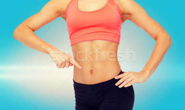 Femme pointant doigt six Pack Photo stock © dolgachov