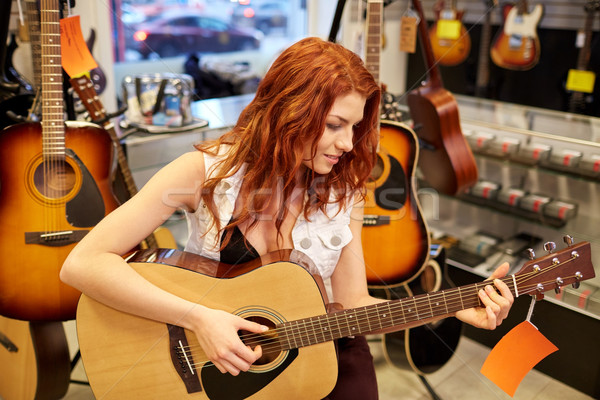 musician or customer with guitar at music store Stock photo © dolgachov