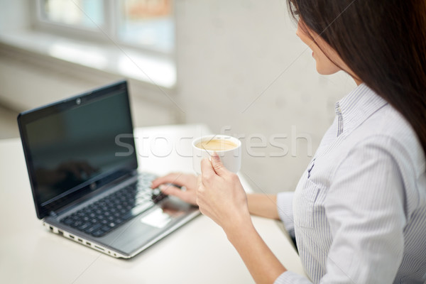 close up of woman with laptop drinking coffee Stock photo © dolgachov
