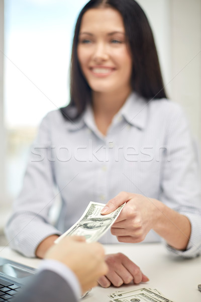 close up of happy woman giving or exchanging money Stock photo © dolgachov