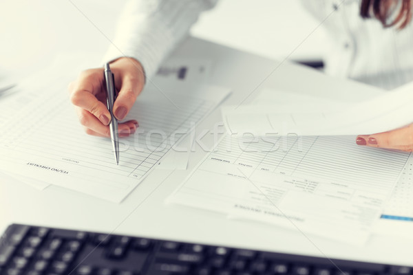 woman hand filling in blank paper or document Stock photo © dolgachov