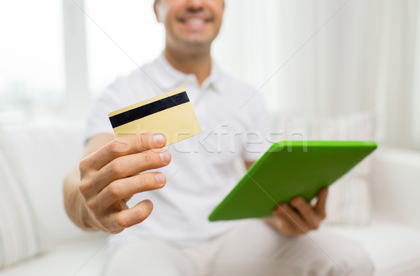 close up of man with credit card and tablet pc Stock photo © dolgachov