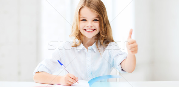 student girl studying at school Stock photo © dolgachov