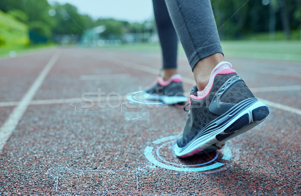 close up of woman feet running on track from back Stock photo © dolgachov