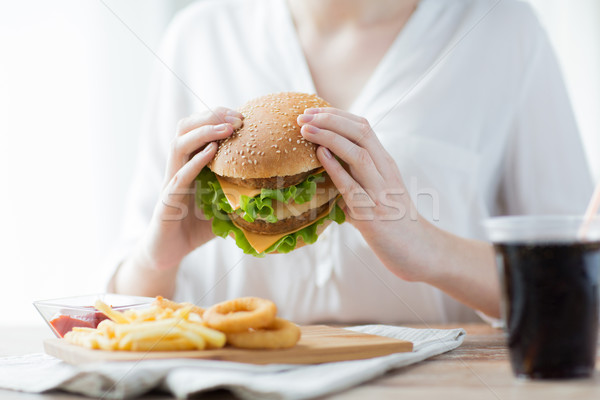 close up of woman hands holding hamburger Stock photo © dolgachov
