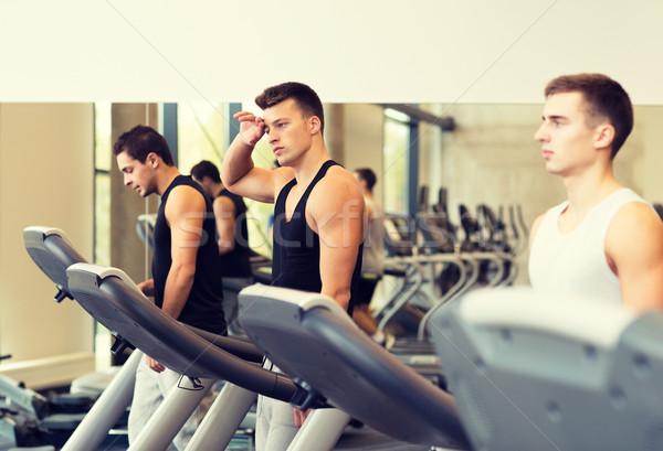 Csoport férfiak testmozgás futópad tornaterem sport Stock fotó © dolgachov