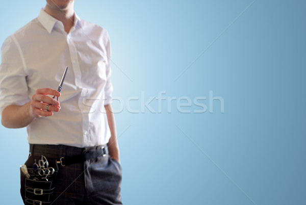 close up of male stylist with scissors over blue Stock photo © dolgachov