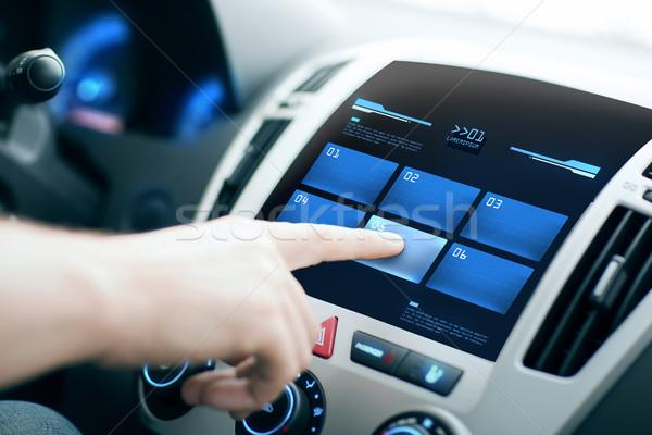hand pushing button on car control panel screen Stock photo © dolgachov