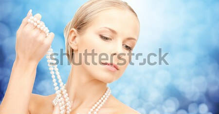 woman in white dress with diamond ring Stock photo © dolgachov