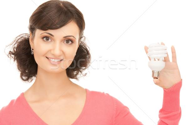 woman holding energy saving bulb Stock photo © dolgachov