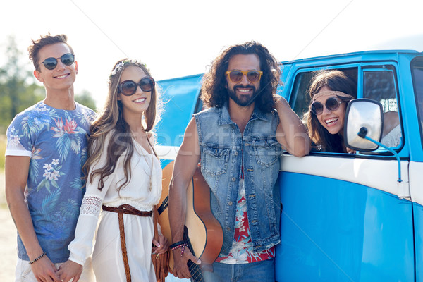 happy hippie friends with guitar over minivan car Stock photo © dolgachov