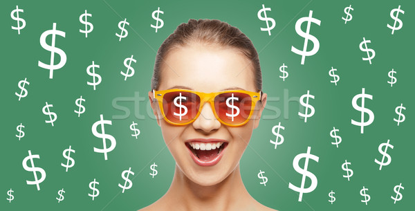 happy woman in shades with dollar currency sings Stock photo © dolgachov