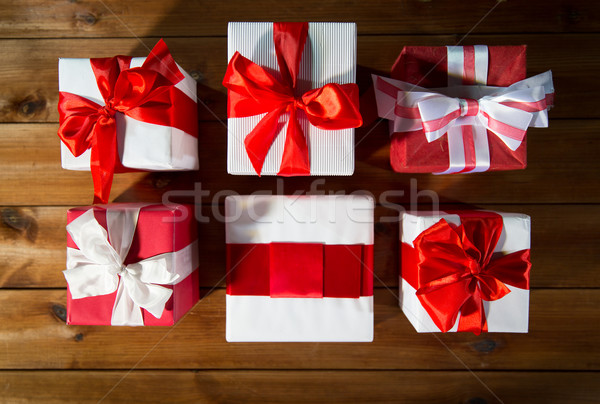 close up of gift boxes on wooden floor from top Stock photo © dolgachov