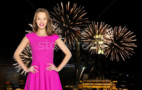 happy young woman over firework at night city Stock photo © dolgachov