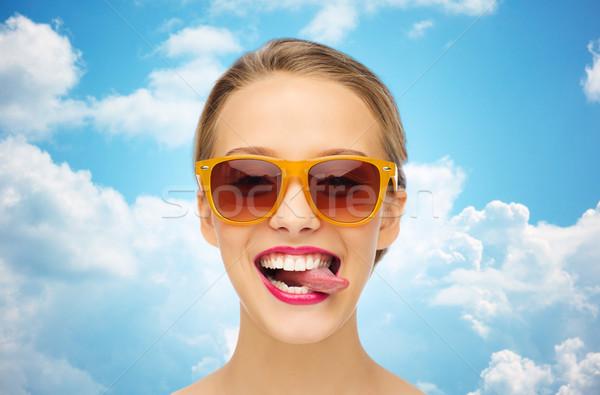Feliz mulher jovem óculos de sol língua pessoas Foto stock © dolgachov