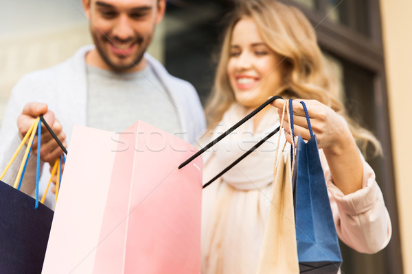 close up of couple with shopping bags on street Stock photo © dolgachov
