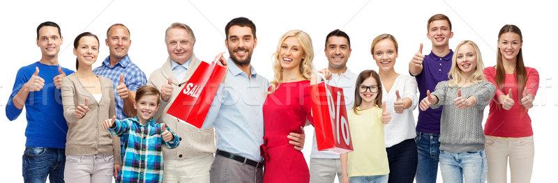 ストックフォト: 幸せな人々 · ショッピングバッグ · ジェスチャー · 販売