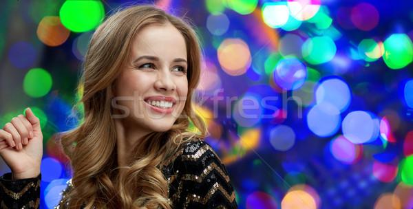 Szczęśliwy młoda kobieta taniec klub nocny disco strony Zdjęcia stock © dolgachov