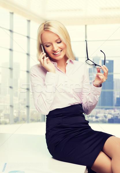 улыбаясь деловая женщина секретарь смартфон образование бизнеса Сток-фото © dolgachov
