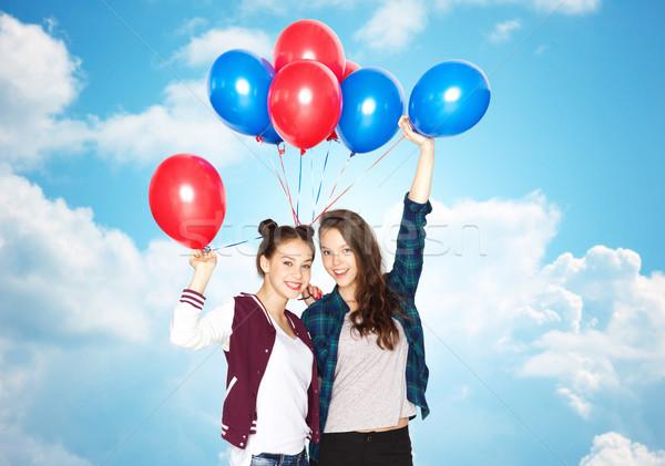 happy teenage girls with helium balloons Stock photo © dolgachov