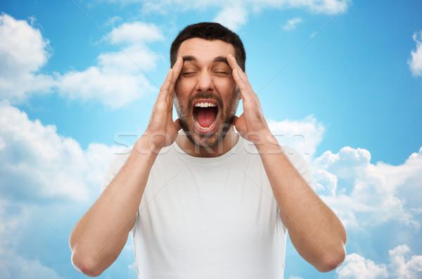 Crazy uomo tshirt cielo blu emozioni Foto d'archivio © dolgachov