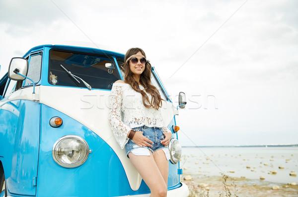 smiling young hippie woman with minivan car Stock photo © dolgachov