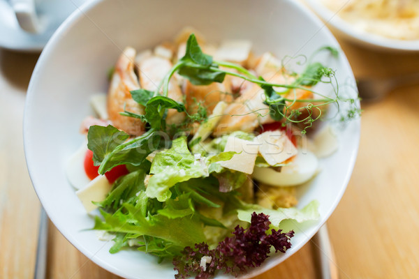 close up of caesar salad on plate at restaurant Stock photo © dolgachov