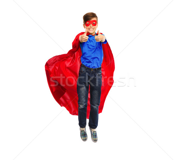 boy in super hero cape and mask showing thumbs up Stock photo © dolgachov
